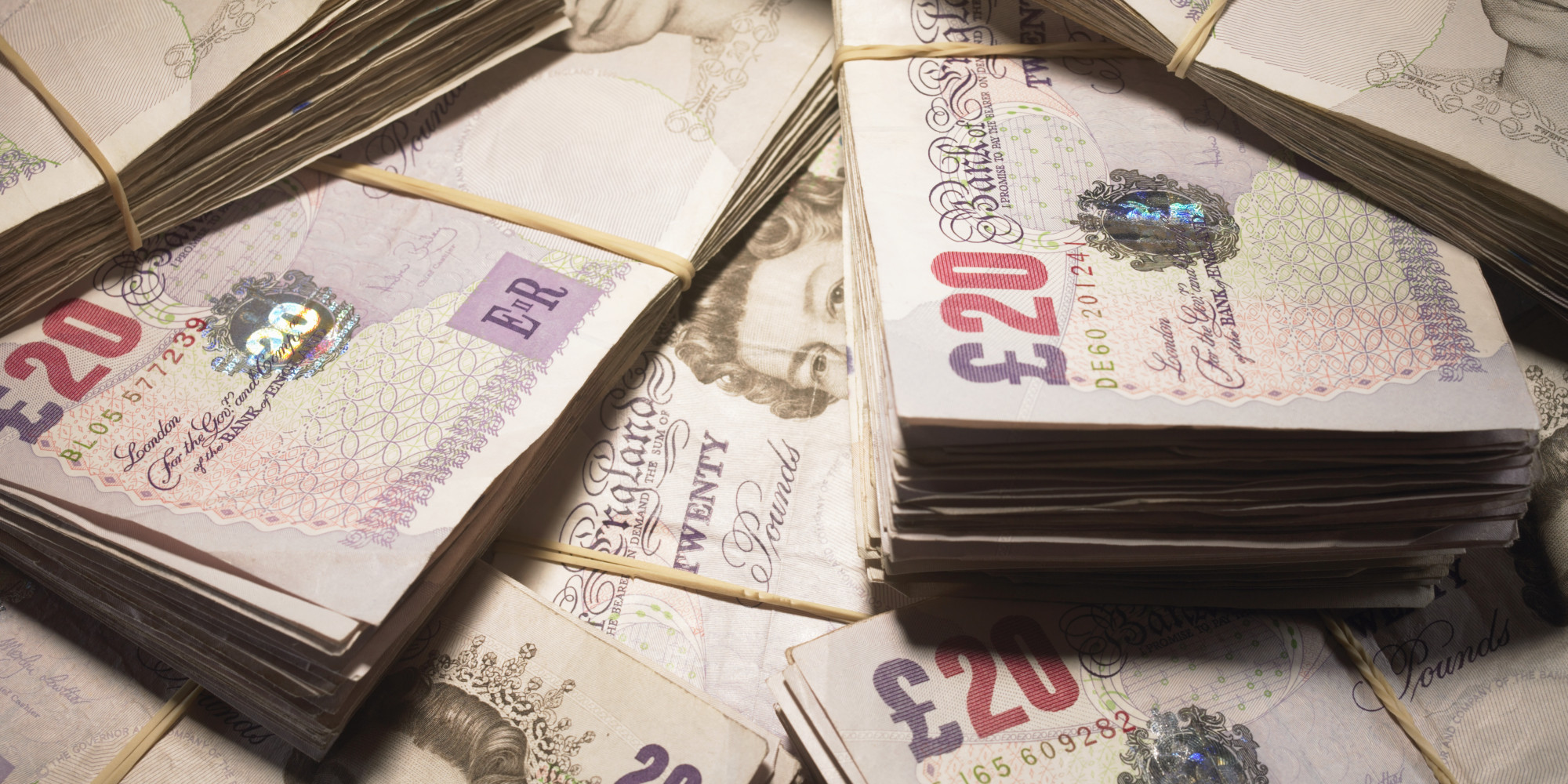 British Currency: Wads of twenty pound banknotes in pile, close-up